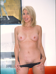 Watch this blonde granny take a big black cock in her poop chute and smile pretty for the camera!