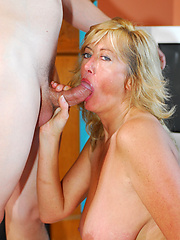 Big-titted mature blond waiting for cock