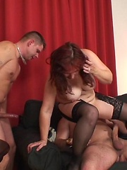 Sexy older redhead pleases cock and the guys cum on her face and her body to feed her