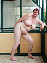 Naughty housewife masturbates on her balcony