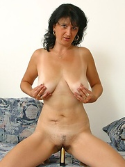 Horny mommy plugs her pussy with a dildo