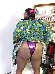 Fat ebony woman  with huge tits