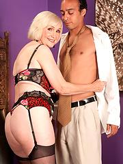 60 yo blond in sexy black stockings rides stud dick