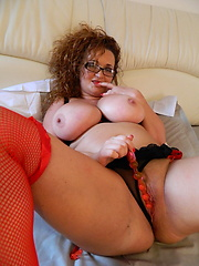 Hot mature in glasses posing on the bed
