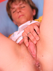 Shy euro mature puts fingers into own hairy pussy