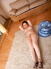 Pretty anilos mature moves apart her pussy lips