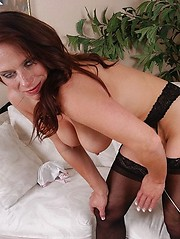 Sexy brunette mature sucking hard cock