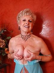 Sexy blond granny spreading her legs