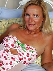 Mature babe  in white fishnet stockings