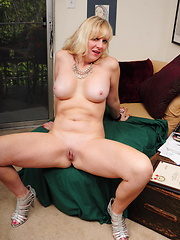 White mature takes off her clothes for naked show