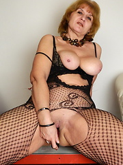Sexy granny grabs her tight anal hole