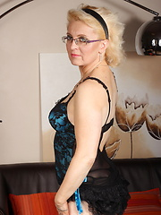Blond mom in tight corset and black stockings toying herself