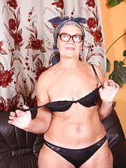 Granny in glasses posing before camera