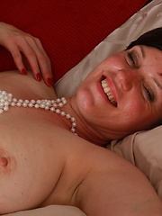 Horny housewife fucking in her bed