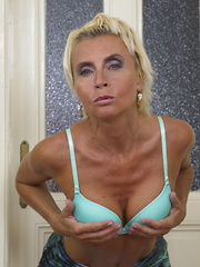 Horny blonde housewife playing with herself