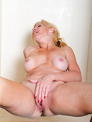 Hot blonde mom shaving her pussy and then touching it