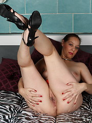 Horny mature housewife playing with her pussy
