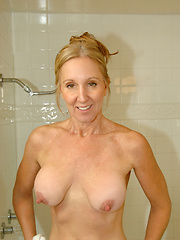 Dripping wet mature lady with big tits fucks a huge toy