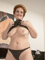 Pplaying with her saggy breasts
