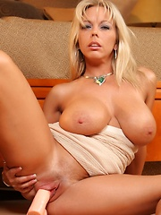 Amber Lynn Bach shows off her sexy body then masturbates with a big dildo.