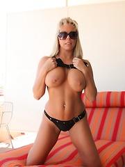 Amber Lynn Bach lounging in the Arizona sun in her sexy bikini.