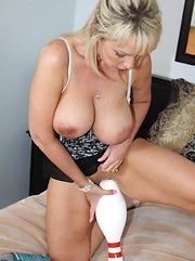 Big tittied Alysha fucks a couple of bowling pins and a giant silver vibrator