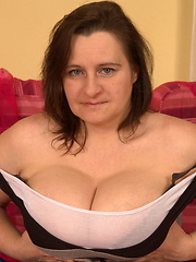 Huge breasted mature slut playing with herself