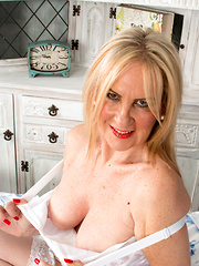 Pretty mommy teases her shaved pink pussy