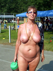 Mature amateurs in a town public nudity action