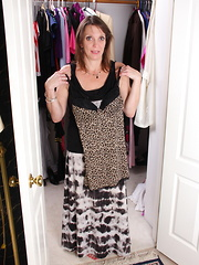 Naughty American housewife dressing up and then some