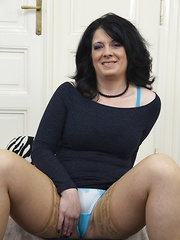 Horny mature lady getting ready to play